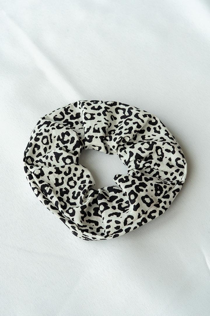 COLECCIÓN SOLSTICIO coletero leopardo blanco